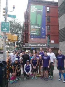 team on 1st Avenue and marathon sign!
