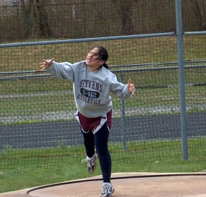 04/2003 - Throwing the discus at a track meet in college