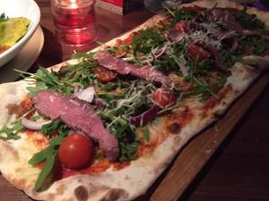 Steak and arugula (rocket) pizza