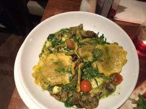 Mushroom and arugula (rocket) filled pasta with mozzarella and pesto sauce